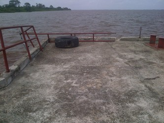 The stelling's rails hang over the Esequibo river