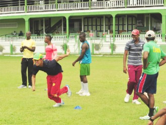 Young batting sensation and son of West Indies test batting legend Tagenarine Chanderpaul does  his fitness drills watched closely by national selector Rayon Griffith at left. (Orlando Charles photo)