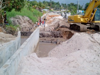 The highway on either side of this ditch has been completed. Engineers say though that work on this aspect of the highway is about 90% complete