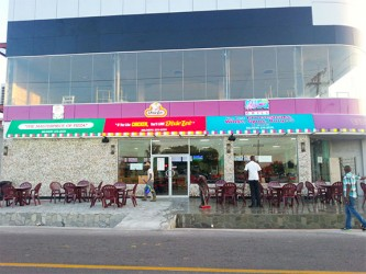 The outside of the fast food establishment as workers prepared it for the special media launch yesterday.