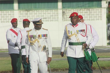 Rear Admiral (rtd) Gary Best (left) and Chief-of-Staff of the Guyana Defence Force Brigadier Mark Phillips walk to the podium for the final inspection of the parade on Tuesday. (Photo by Arian Browne)