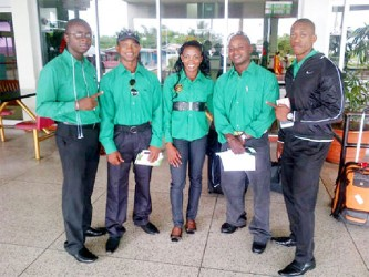 Reigning Mr. Guyana, Kerwin Clarke (extreme right) as well as Devon Davis (second from left) and Alisha Fortune pose with president of the GABBFF, Keavon Bess (extreme left) and Mervyn 'Spongy' Moses before departing yesterday for the Dominican Republic to compete in the 41st CAC Bodybuilding and Fitness Championships.