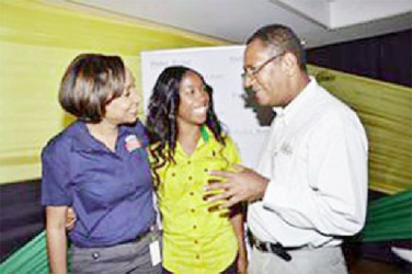 Anthony Lawrence (right), Global Brand Manager, Grace Foods and Tania Christie (left), Marketing Manager, Grace Foods commend the company's 'Ambassador', Shelly-Ann Fraser-Pryce.