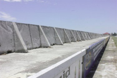 Part of the mobile wave wall on the seawall along the Rupert Craig Highway from Liliendaal to Conversation Tree. (Stabroek News file photo)