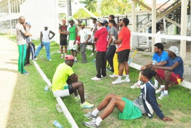 Chairman of the national selectors Rayon Griffith gives the Berbice players a pep talk. (Orlando Charles Photo)