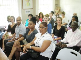New volunteers attached to Cuso Guyana sit among its representatives and other partners.