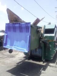 Compactor at Orange Walk, Bourda
