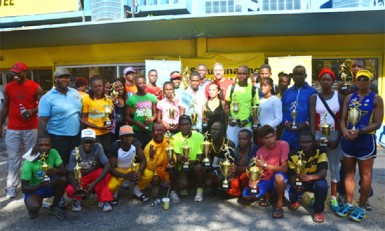 The Courts top five finishers of the various categories with their trophies after the presentation ceremony yesterday morning in front the Courts Main Street branch.