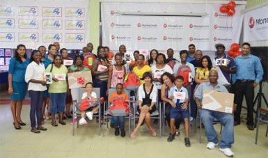Winners in MoneyGram's 'Back to School Promotion' display their prizes.