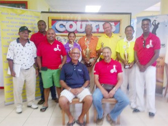 Maurice Solomon (fourth right standing ) with other winners while Courts Managing Director Clyde DeHaas and Lusignan Golf Club President Jerome Khan  are sitting.