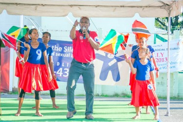 Reverend Charles of the Flaming World Ministry preformed a song calling for an end to child abuse, while engaging the Sophia Centre Dance Troupe on Wednesday at the National Park (Photo by Arian Browne)