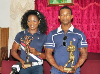 Alisha Fortune and Devon Davis pose with their hardware from this year's 41st Central American and Caribbean (CAC) Bodybuilding and Fitness Championships which was staged in the Dominican Republic. Absent is Kerwin Clarke. (Orlando Charles photo)