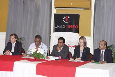 From left are Reynir Gretarsson, Chairman of Creditinfo International; Prime Minister Sam Hinds; Attorney General Anil Nandlall; Canadian High Commission Nicole Giles; and Deputy Governor of the Bank of Guyana Dr. Gobind Ganga at the launch of Creditinfo at the Georgetown Club yesterday. (Photo by Arian Browne)