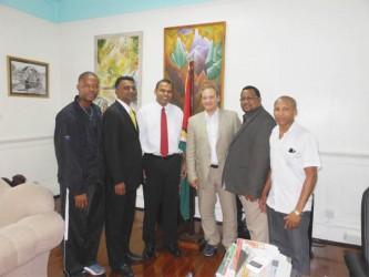SAMBO GATHERING! From left, Carwyn Holland (President of GSCSF), Samuel Sankar, Minister  Dr. Frank Anthony, Dr. Andrey Moshanov (Head of Development FIAS), Jason Fraser(President TTSCSF) and Devon Jones (Vice President GSCSF).