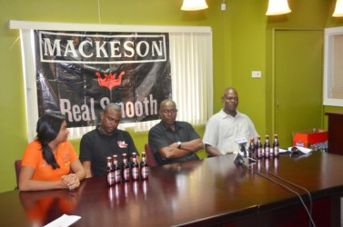 Technical Director of the GBA, Terrece Poole, (extreme right) makes a point a yesterday's launch of the' Mackeson Fight Night' as Ansa McAL's Darshanie Yussuf, Jamal Douglas and GBA's head, Steve Ninvalle look on.