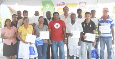 Graduates from Sterling Products Limited's literacy programme and coordinators and other officials after the graduation exercise