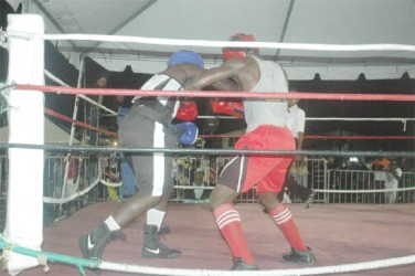 Action between Marvin Ageday (blue) and Williams Hendricks Sunday night.
