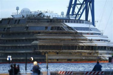 "The capsized cruise liner Costa Concordia is seen at the end of the ""parbuckling"" operation outside Giglio harbour September 17, 2013. REUTERS/Tony Gentile"