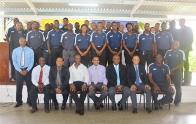 Members of the FIFA Rap Launch Committee sitting from left to right: GFRC Secretary Troy Peters, GFF Vice President Ivan Persaud, GFRC President Alfred King, Minister of Culture Youth and Sport Frank Anthony, GFF President Christopher Matthias, FIFA Referees Instructor Peter Prendergast and FIFA Fitness Instructor Allan Brown while the  participating referees stand at the back.