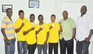 The medalists at the inaugural South American Youth Games (from left) Travis Fraser, Joel Williamson, Tefon Green and Michael April pose for a photo opportunity with Coach Wincel Thomas (left) as well as GBA's president, Steve Ninvalle and Technical Director, Terrence Poole (right). (Orlando Charles photo)
