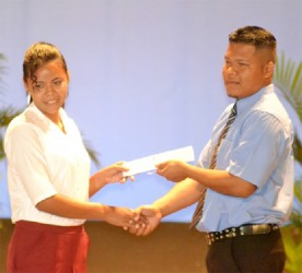 A student from the North West Secondary School receives her SCCP Certificate (GINA photo)