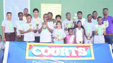 Tournament participants posing with their respective trophies.