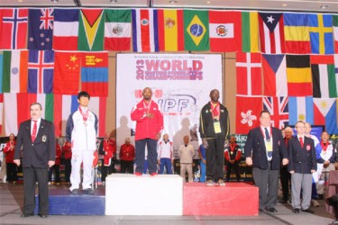 Winston Stoby (right) on the podium at the World Masters Championships last Tuesday in Orlando, Florida.