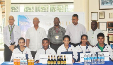 Newly appointed Banks DIH sport ambassadors  (seated from left to right) Christine Sukhram, Neil Reece, Ashley De Groot, Soroya Simmons and Daniel Lopes along with company executives (from left to right) Andrew Carto, Clifford Reis, George McDonald, Michael Pereira and Troy Peters. The sixth ambassador, Stefan Corlette is not in photo.