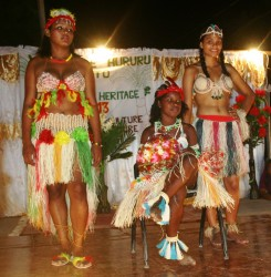 Lensey Adolph, the newly crowned Miss Hururu Heritage 2013, flanked by first runner-up, Malika Russell (right) and Gracelyn Campbell (left)