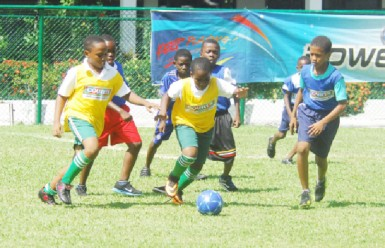 Action in the Petra Organisation/Courts Courts Guyana Incorporated in collaboration with Banks DIH Limited Pee Wee football tournament at Thirst Park yesterday.