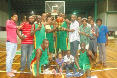 Repeat champions Albouystown/Charlestown posing with the Championship trophy as well as their replicas and individual awards.