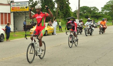 Roraima Bikers Club, Marlon 'Fishy' Williams celebrates as he crosses the finish line in yesterday's 11th annual Victor Macedo road race. (Orlando Charles photo)