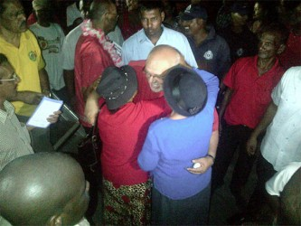 The President embraces some of his supporters after the Rally