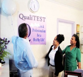 Prime Minister Samuel Hinds and his wife Yvonne Hinds unveil the plaque to the QualiTEST Lab with CEO Yvette Irving (GINA photo)