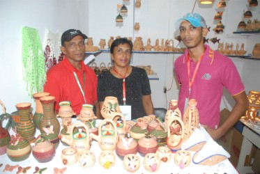 Family entrepreneurship at GuyExpo:  Nandkishore and Sara, proprietors of N&S Andrews, Potters of Wakenaam and their son Jan.