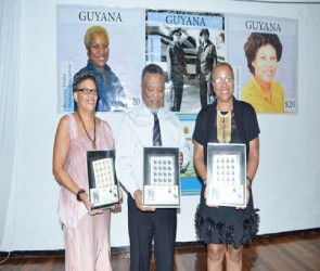 Prime Minister Samuel Hinds flanked by Cheryl Moore and Beverley Drake in whose honour commemorative stamps were launched  (Government Information Agency photo)