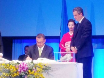 Minister of Natural Resources and the Environment Robert Persaud signing the Minamata Convention on Mercury in Minamata, Japan (Government Information Agency photo)