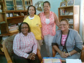 President of the GWMO Simona Broomes, seated at left, along with GWMO US member Sonja Fiedtkou-Perry and local member Dana Jones with Head of the Carnegie School of Economics Penelope Harris, seated at right, during initial talks on the training of women miners at the organization