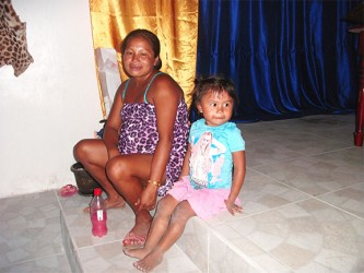 A pregnant Leslyn Joseph and her daughter at Isseneru.