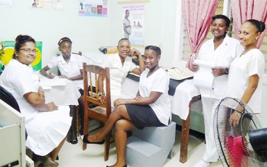 Head nurse of Lichfield Health Centre, Soma Persaud, and other staff taking a  break from their work
