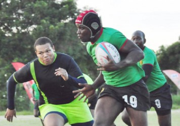 Avery Corbin evades Rondel Mc Arthur to record one of his two tries in the final of yesterday's Banks Sevens Championships. (Orlando Charles photo)