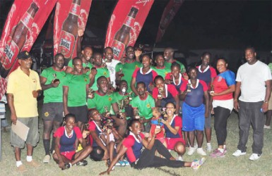 Winners of the Banks Sevens Championships GDF (male) and Hornets (female) pose with their hardware following yesterday's tournament at the National Park Rugby field. (Orlando Charles photo)