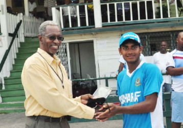 Man of the moment! Mehedy Miraj receives his man of the match award from Grantley Culbard. (Orlando Charles photo)