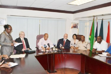 Minister of Home Affairs, Clement Rohee (third from left)  and Director of The Emergence Group, Dennis Hays (second from left) during the signing of the contract to establish the SWAT Unit. (GINA photo)