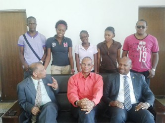 The five SVG students (standing pose with Agriculture Ministers Dr Leslie Ramsammy (left) and Sabato Caesar (right) and another local official.