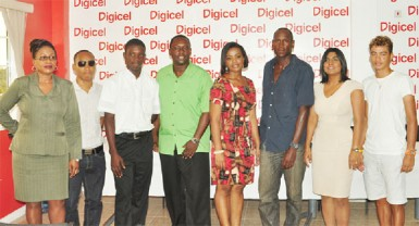 Representatives of Digicel, Executives of the Guyana Cycling Federation as well a top junior cyclist, Hamza Eastman and defending Digicel Breast Cancer Awareness road race champion, Paul DeNobrega, pose for a photo opportunity following the launch of this year's edition yesterday. (Orlando Charles photo)