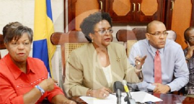Opposition leader Mia Mottley (centre) flanked by MPs Cynthia Forde (left), Kerrie Symmonds and Trevor Prescod.