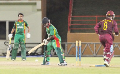 The West Indies U19s celebrate the wicket of Mossadek Saikat. (Orlando Charles photo)