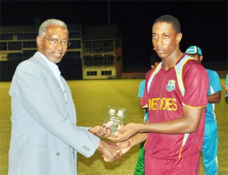 Preston Mc Sween receives his man of the match award from Grantley Culbard.