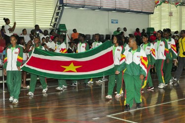 Suriname's delegation arriving at the Ismay van Wilgen Sporthal for the opening ceremony of the second leg of this year's Inter Guiana Games. (Orlando Charles photo)